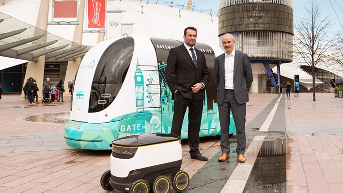 RSA's Kenny Leitch and Ian Kemp stand in front of the GATEway driverless pod - credit RSA / MSL