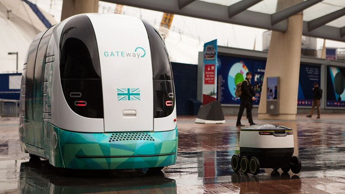 Side by side, two types of autonomous vehicles being tested by the GATEway project - a driverless pod for humans, and a drone delivery cart - credit RSA / MSL