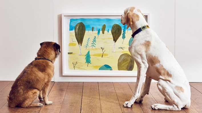 But is it art? Two dogs look at the same painting - painted using colours that only dogs can see - at MORE TH>N's Play More interactive art exhibition for dogs. Copyright MORE THAN