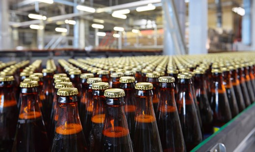 Bottles of beer (not  branded) on a production line. Source Fotolia 59835403.
