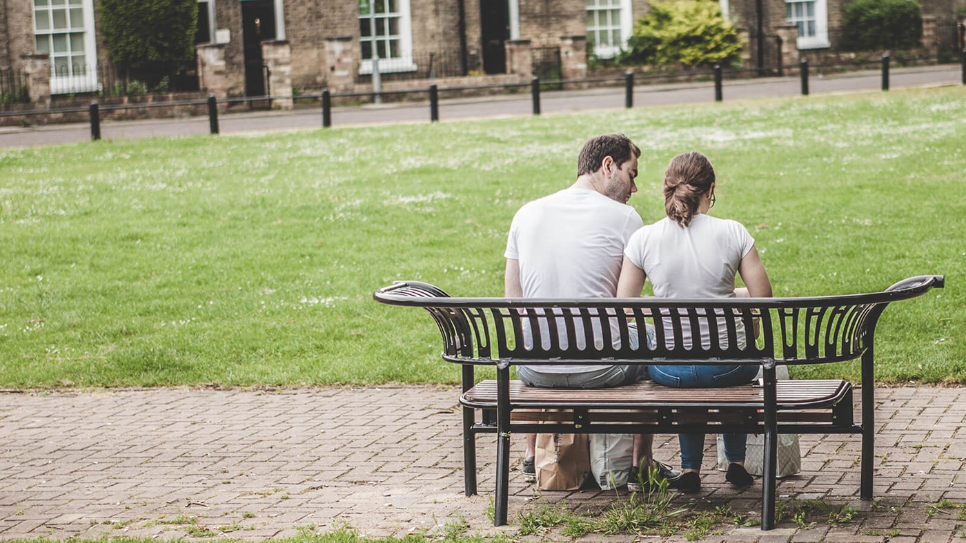 park bench couple chatting credit Clem Onojeghuo cc